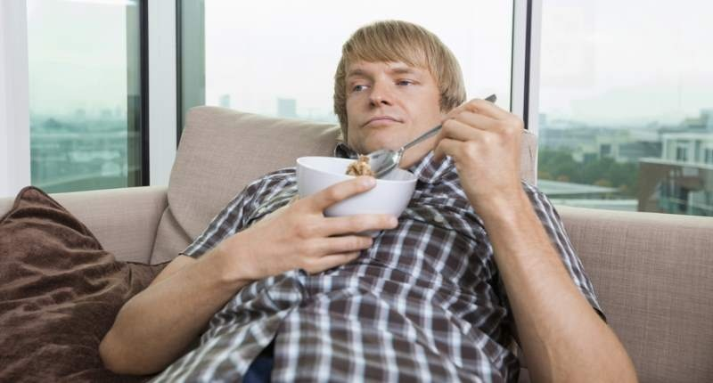 Man-with-bowl-of-cereal-in-living-room-Shutterstock-800x430
